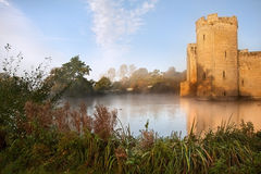 Stunning moat and castle in Autumn Fall sunrise Royalty Free Stock Images