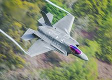 Stunning modern stealth fighter jet F35. Stunning modern stealth fighter jet flight over the UK, F35 lightning II.  Dutch, Japanese, American and UK RAF are some royalty free stock photography