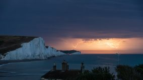 Stunning moody electrical lightning storm over white cliffs land. Amazing dramatic electrical lightning storm over white cliffs landscape, on English South Coast Royalty Free Stock Images
