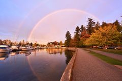 Stunning morning rainbow in Stanley Park, Vancouver Royalty Free Stock Images