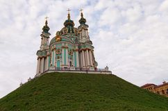 Stunning morning view of Saint Andrew`s Church. Iconic landmark for locals and tourists. Scenic landscape view. Cathedral against cloudy sky. Kyiv, Ukraine royalty free stock images