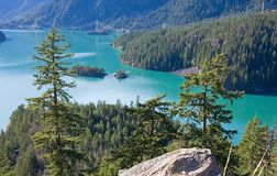 Stunning Mountain Lake. This gorgeous stunning mountain lake is Ross Lake located in Washington state with brilliant aquamarine colored water and a small island Stock Image