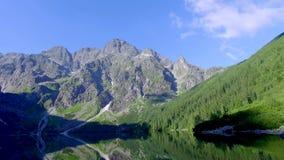 Stunning mountain Lake in the Tatra Mountains at dawn, Poland stock video