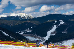 Stunning mountain view in a ski-resort. On a sunny day in winter period Royalty Free Stock Photography