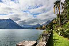 The stunning mountain and water views of Lake Como. The stunning views of the mountains and waters of Lake Como from a villa in Varenna Italy royalty free stock photo