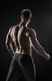 Stunning muscular man fitness model torso showing muscles back Royalty Free Stock Photos