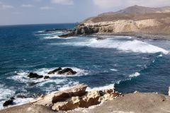 Stunning natural viewpoint with amazing cliffs and blue rough sea at north-west coast of Fuerteventura, Canary Islands, Spain stock image
