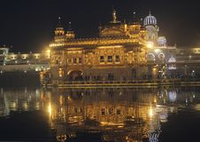Stunning night view of golden temple, reflection of light royalty free stock photo