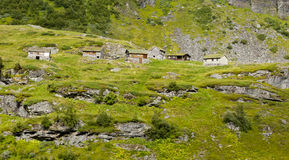 Stunning Norwegian mountain landscape. With little houses Royalty Free Stock Image