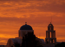 Stunning Orange Gradation of the Sunset Afterglow over a Church in Santorini, Greece Stock Photo