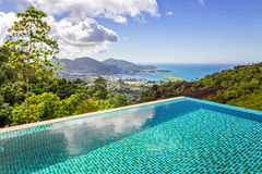 Stunning panoramic view of Mahe island, Seychelles from crystal. Clean blue swimming pool royalty free stock images