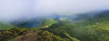 Stunning panoramic view on volcanic lakes. Green Lagoa de Santiago and blue Lagoa Azul with Sete Cidades village