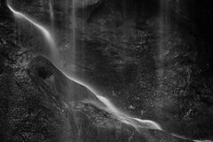 Beautiful peaceful black and white long exposure waterfall detai. Stunning peaceful black and white long exposure waterfall detail intimate landscape image Stock Images