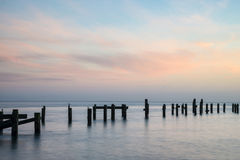 Stunning peaceful sea landscape of old derelict pier foundations Royalty Free Stock Photography