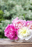 Stunning peonies in white wicker basket Stock Photo