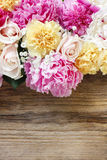 Stunning pink peonies, yellow carnations and roses Royalty Free Stock Photo