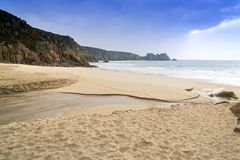 Stunning Porthcurno Beach landscape in Cornwall England. Beautiful Porthcurno Beach landscape in Cornwall England Stock Images