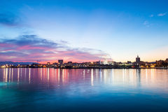 Stunning purple sky with clouds Malaga city. Andalusia, Spain. Blue and purple sky. Sunset in the marina port Royalty Free Stock Photos