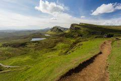 Stunning Quiraing trail view over the green cliffs, lochs, and t stock photography