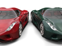 Stunning red and dark green supercars beauty closeup shot. Isolated on white background Stock Photos