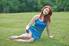 Stunning red haired woman outside - summer Stock Photography
