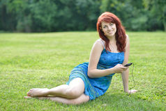 Stunning red haired woman outside - summer Royalty Free Stock Photo