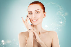 Stunning red haired woman skin health concept, blue background Royalty Free Stock Photo