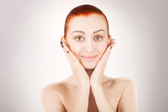 Stunning red haired woman skin health concept, grey background Royalty Free Stock Image