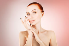 Stunning red haired woman skin health concept, pink background Stock Image