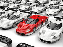Stunning red modern concept sports car stands out in a sea of white sports cars. Isolated on white background Royalty Free Stock Photo