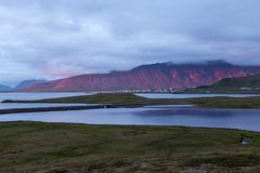 Stunning red mountain behind Grundarfjordur town. Stunning red mountain behind Grundarfjordur town lit up by the sunset. Amazing rural landscape by the Atlantic royalty free stock photos