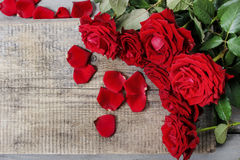 Stunning red roses on wooden table