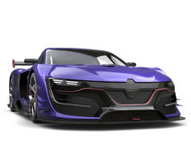 Stunning regalia purple super car - front view. Isolated on white background Stock Images