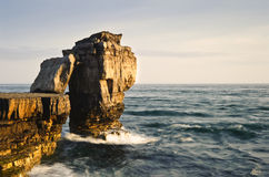 Stunning rock cliff formations with waves crashing Royalty Free Stock Image