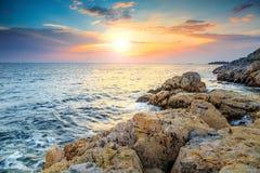 Stunning rocky beach and beautiful sunset near Rovinj,Istria,Croatia Royalty Free Stock Photo