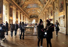 Stunning scene in one of many rooms, with sightseers admiring masterpieces,The Louvre,Paris,2016. Gorgeous detail of interior architecture in one of many rooms Stock Photo