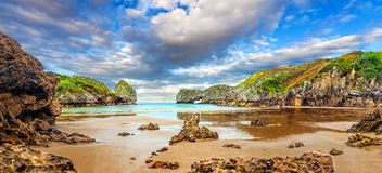Vivid landscape of beach and coast with mountains and vegetation Royalty Free Stock Photography