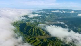Stunning scenery of Kintamani mountain. With mist under blue sky in Bali, Indonesia Royalty Free Stock Photos