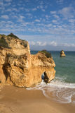 Stunning sea caves cliffs on sandy camilo beach in blue sky Royalty Free Stock Image