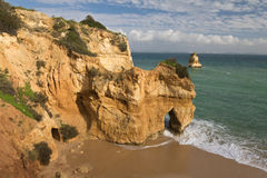 Stunning sea caves cliffs on sandy camilo beach Stock Image