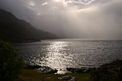 Stunning seascape with sunlight breaking through the clouds stock image