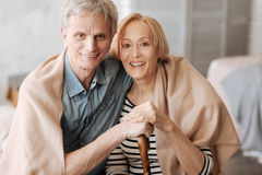 Stunning senior couple enjoying their time together. Closer than ever. Attractive emotional mature people sitting near each other and having some good time while stock photo