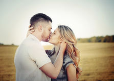 Stunning sensual young couple in love kissing at the sunset in f royalty free stock image