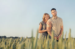 Stunning sensual young couple in love posing in summer field. Happy lifestyle concept Royalty Free Stock Photography