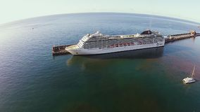 Amazing cruise ship in docks of Madeira island, Portugal, aerial shot. Stunning shot of massive cruise ship parked in docks of Madeira stock video