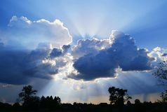 A stunning shot of the sun`s rays breaking through the clouds. stock image
