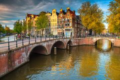 Spectacular water canals with bridges and colorful houses, Amsterdam, Netherlands stock images
