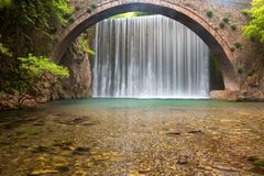 Stunning spring landscape.Paleokarya, old, stone, arched bridge, between two waterfalls. Trikala prefecture Thessaly Greece stock photos