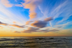 Stunning stratus cloud formations at sunset over the Baltic sea. Stock Image