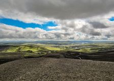 Stunning summer landscape of Iceland: black volcanic mountains covered with soft green moss royalty free stock photography